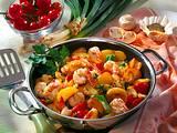 Bratkartoffeln mit Garnelen, Champignons und Tomaten Rezept