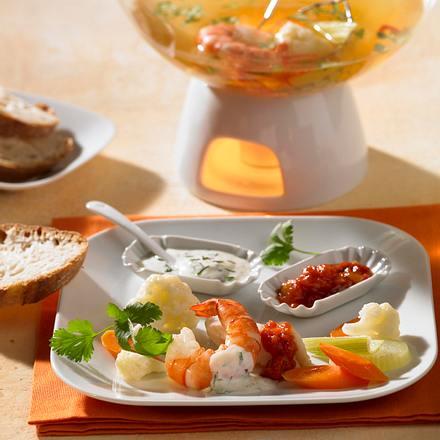 Brüh-Fondue mit Fisch und Garnelen Rezept