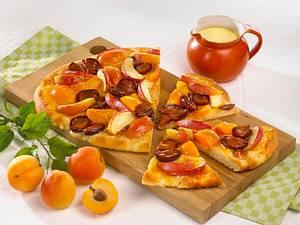 Bunte Früchte Pizza mit Puderzucker Rezept