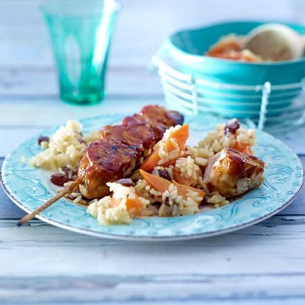 Cajun-Chicken am Stiel mit Möhren-Rosinen-Reis Rezept