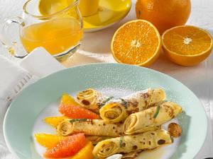 Crêpes-Röllchen mit Zitrusfrüchten Rezept
