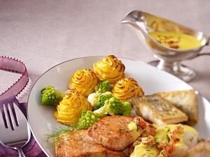 Edelfischplatte mit Safran-Hollandaise und Herzoginkartoffeln Rezept