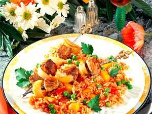 Fleischspieße auf buntem Reis Rezept
