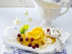 Gebratene Ananasscheiben mit Cranberries und Mandelcreme Rezept