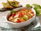 Gratiniertes Schnitzel mit Tomate und Mozzarella Rezept