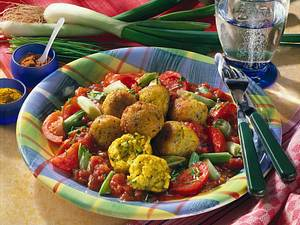 Hirseklößchen auf Tomaten Rezept