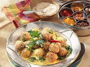Indische Kartoffelbällchen mit Curry-Spinat Rezept