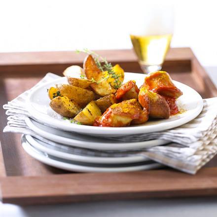 Kartoffelspalten mit Currywurst Rezept