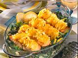 Lachs mit Meerrettich-Kartoffel-Kruste auf Spinat-Lachstranchen Rezept