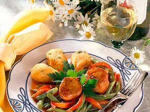 Medaillons auf Gemüse und gebackenen Käse-Kräuter-Kroketten Rezept