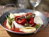 Ofenkabeljau mit gerösteten Paprika in Tomatensoße Rezept