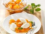 Quarknocken auf Aprikosen  Rezept