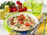 Risotto mit Rauke, Tomaten und Parmaschinken Rezept