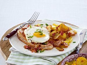 Schnitzel Strammer Max zu Bratkartoffeln Rezept