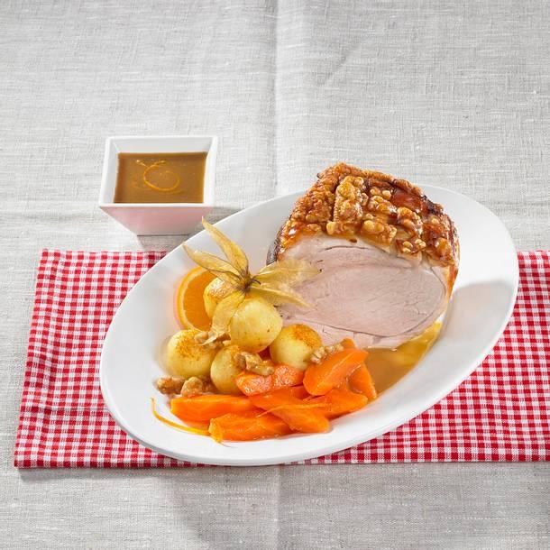 Schweinekrustenbraten mit Orangen-Möhren Rezept