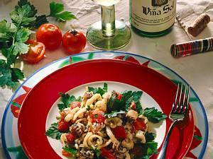 Tintenfische mit Zwiebeln und Tomaten Rezept