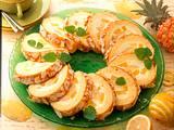 Zitronen-Ananas-Biskuitrolle Rezept