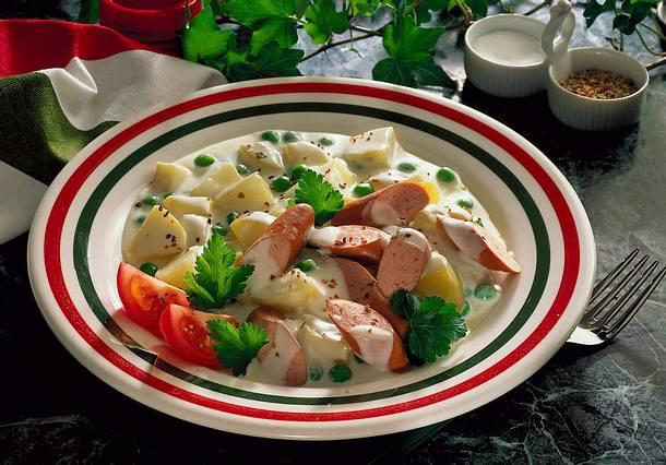 Béchamelkartoffeln mit Erbsen und Wurst Rezept
