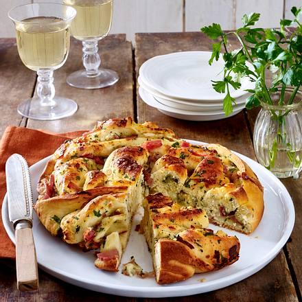 Brotrad mit Käse, Knobi, Schinken und Zwiebeln Rezept