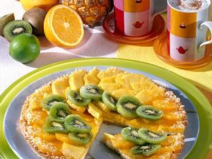 Bunter Obstkuchen mit Ananas, Kiwi und Clementinen auf Kokoscreme Rezept