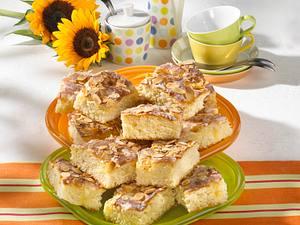 Butterkuchen mit Guss und Mandelblättchen Rezept