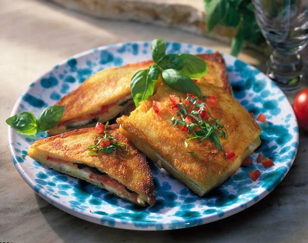 Carozza (gebackene Tomaten-Mozzarella-Toasts) Rezept