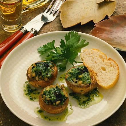 Champignons mit Schnecken gefüllt Rezept