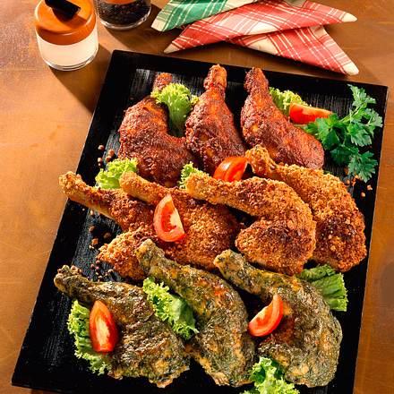 Dreierlei Hähnchenkeulen mit Erdnusspanade, Kräutern und Tandoori Rezept