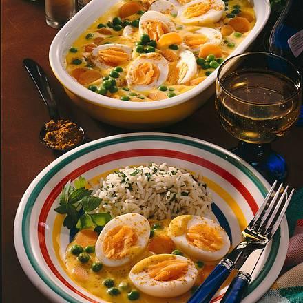 Eier in Currysoße mit Reis Rezept