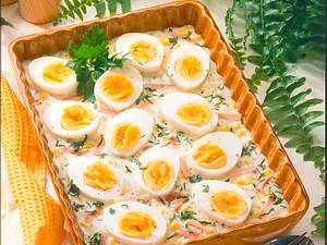 Eier in Kräuter-Schinkensoße Rezept