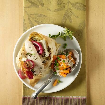 Feta-Fischpäckchen mit Gemüsereis Rezept