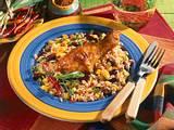 Feurige Hähnchenkeule auf buntem Reis Rezept