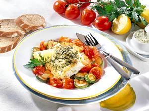 Fischfilet in Kräuterbutter auf Zucchini-Tomaten-Gemüse Rezept