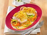 Fischfilet mit Kartoffelkruste auf Gemüsebett Rezept
