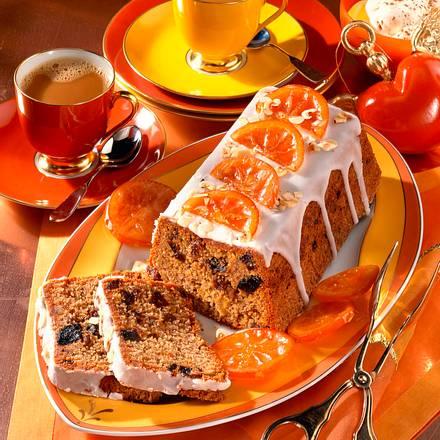 Früchtekuchen mit Zitronenguss und kandierten Orangen Rezept