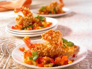 Garnelen in Nusskruste auf gebratenen mediterranen Gemüsewürfeln Rezept