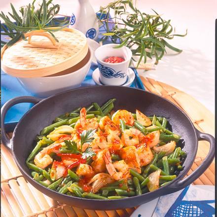Garnelen und Fischstücke in scharfer Soße Rezept