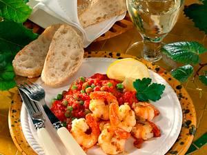 Gebratene Garnelen zu Erbsen-Tomatengemüse Rezept