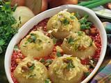 Gefüllte Gemüsezwiebel mit Pilzrisotto Rezept
