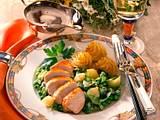 Glasierte Hähnchenbrust auf Erbsen-Schalotten-Gemüse Rezept