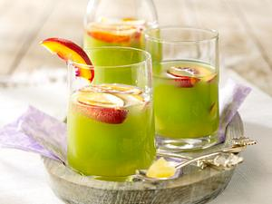 Grüne Bowle mit Ananas, Aprikosen und Blue Curacao Rezept