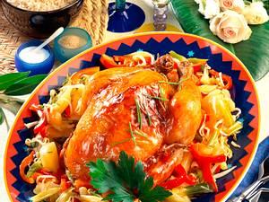 Hähnchen süß-sauer auf Gemüsebett Rezept