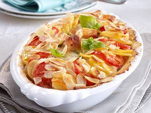 Hähnchenragout im Kartoffel-Tomaten-Gratin-Rand Rezept