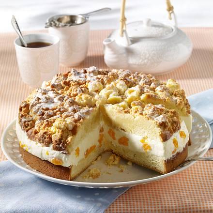 Käse-Sahne-Torte mit Orangenstreuseln Rezept