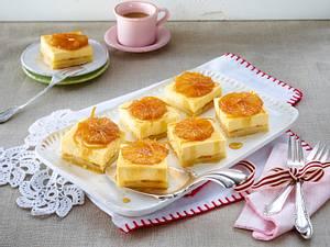 Käsekuchen-Würfel mit Likör-Orangen Rezept