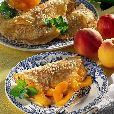 Kokoscrêpes mit Karamellpfirsichen Rezept