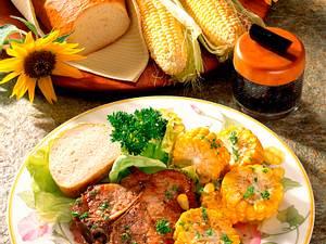 Koteletts mit Zuckermais in Kräuterbutter Rezept