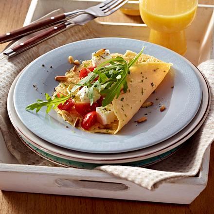 Kräuter-Omelett mit Tomaten, Rauke und Schafskäse Rezept