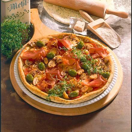 Kräuterpizza mit Parmaschinken Rezept