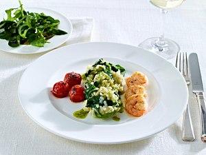 Kräuterrisotto mit Schmortomaten, Tiefseekrabben und Frühlingskräutersalat Rezept